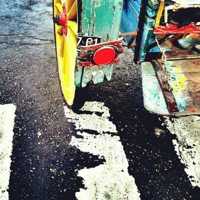 yellow Wheels Painting Weathered Streetphotography Instafamous Instanusantara Instagood Photooftheday Colormadness Pictureoftheday Bali INDONESIA LangitBaliPhotowork