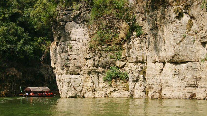 Boat trip... Boat People Feel The Journey Tree Bush Bushes River Riverside River View Rock Rocks Rock Wall Rocky Mountains Mountain Nature Nature Photography Chinese Nature Green Water Sea Small Boat On The River