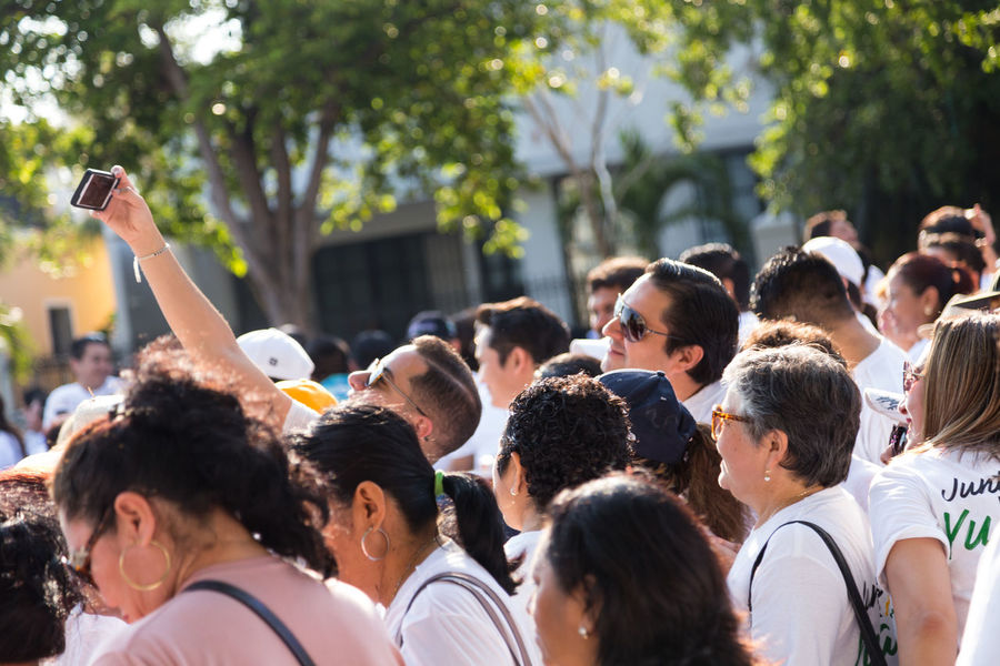 A man taking a selfie with his friends in the Mayor 1st International Workers' day celebration. Selfıe Young Man Adult Workers May 1, 2018 Workers Workersday EyeEm Selects Crowd Young Women Togetherness Men Portrait Popular Music Concert Vitality Cheerful Arms Raised