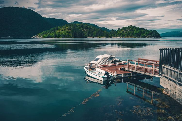 Norwegian Fjord and the Small Marina Marina Norway Beauty In Nature Cloud - Sky Day Fjord Fjords Lake Moored Mountain Nature Nautical Vessel No People Outdoors Reflection Scenics Sky Tranquility Transportation Tree Water Waterfront