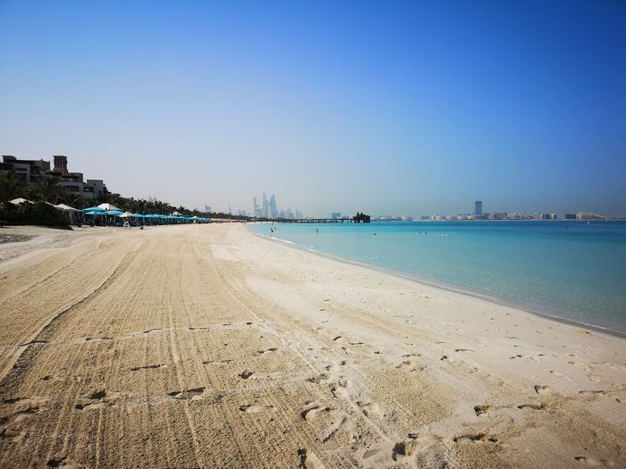 EyeEm Selects Water Clear Sky Sea Beach Sand Blue Horizon Summer Sun Sunny Low Tide Headland Seascape Beach Hut Horizon Over Water