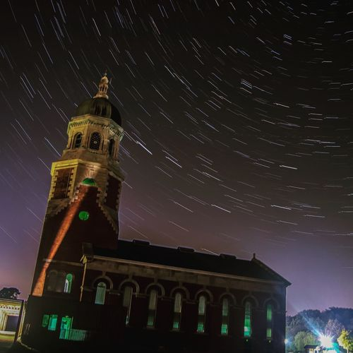 startrails behind the royal victoria military hospital chapel at royal victoria country park Astronomy City Star - Space Galaxy History Constellation Sky Architecture Building Exterior Built Structure Star Trail Space And Astronomy Astrology Infinity Starry