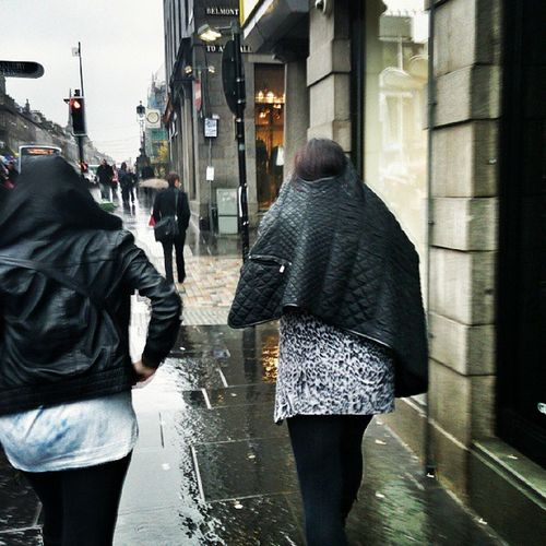 """This girl took off her jacket and put it over ger heid to stop """"her bonnie hair getting pure soaked"""" lol epic FAIL love!!! So glad I got a pic :) Mycamerastories Wethair  Fail Epicfail laugh town aberdeen itsraining neep"""