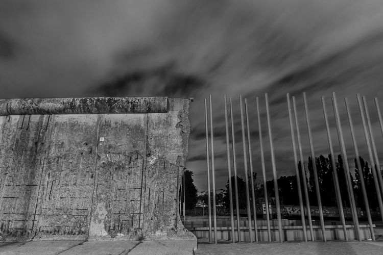 Low angle view of abandoned wall against sky