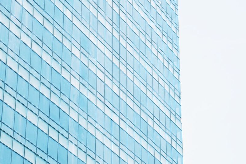 Architecture Building Exterior Built Structure Low Angle View Modern Office Building City Clear Sky Skyscraper Repetition Blue Tall - High Glass - Material Urban Skyline Tower Building Story Place Of Work Day Sky Development EyeEm Gallery Geometric Shape Eyem Vision