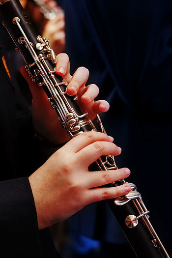 Midsection of person playing flute