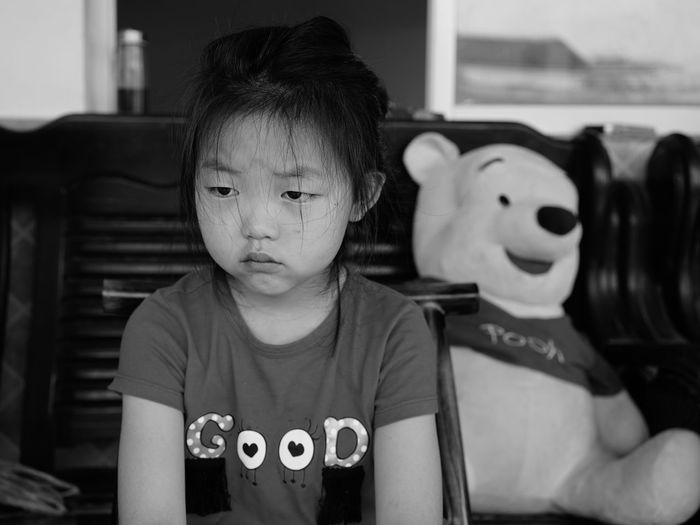 The Portraitist - 2018 EyeEm Awards Black And White Casual Clothing Child Childhood Focus On Foreground Front View Innocence Lifestyles One Person Portrait Real People Toy