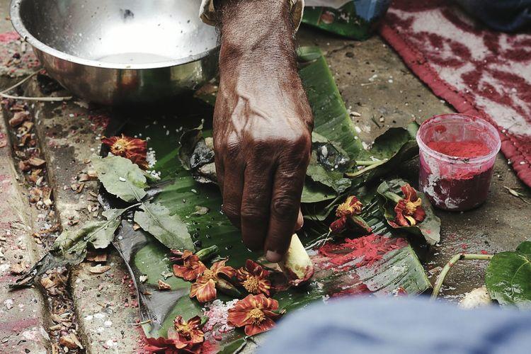 Close-Up Of Man Performing Ritual