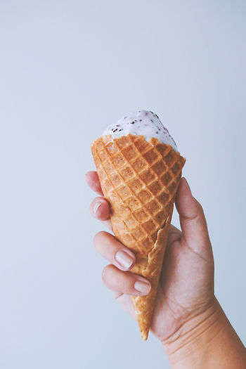 Female hand fingers hold a waffle cone with ice cream. Yami sweet food summer season concept Ice Cream Cone Waffle Hand Female Summer Sweet Abstract Background Care Closeup Cold Collage Color Colorful Concept Cream Creamy Dairy Dessert Eating Food Fresh Frozen Gelato Happy Healthy Holding Holiday Isolated Lifestyle Minimalism Natural Object Party Product Snack Soft Strawberry Sugar Tasty Tube Vanilla White Woman Yami Full Ice-cream