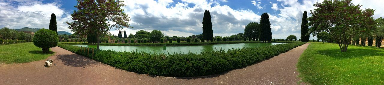 tree, sky, cloud - sky, water, green color, growth, nature, park - man made space, panoramic, day, plant, outdoors, no people, beauty in nature, scenics, architecture, grass