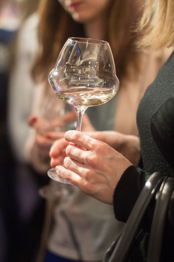 Glass Drink Alcohol Holding Adult Refreshment Women One Person Wine Wineglass Indoors  Food And Drink Leisure Activity Real People Midsection Lifestyles Focus On Foreground Hand Selective Focus Drinking