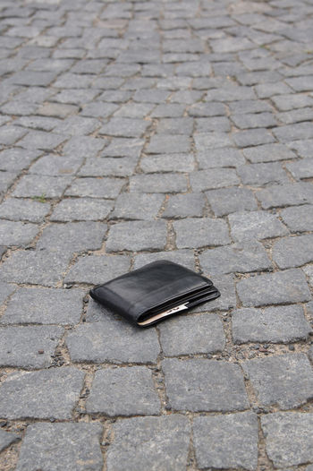 Copy Space Finding Losing Lost Wallet Black Leather Wallet Cash Found Ground Money No People Outdoors Pavement Purse Street