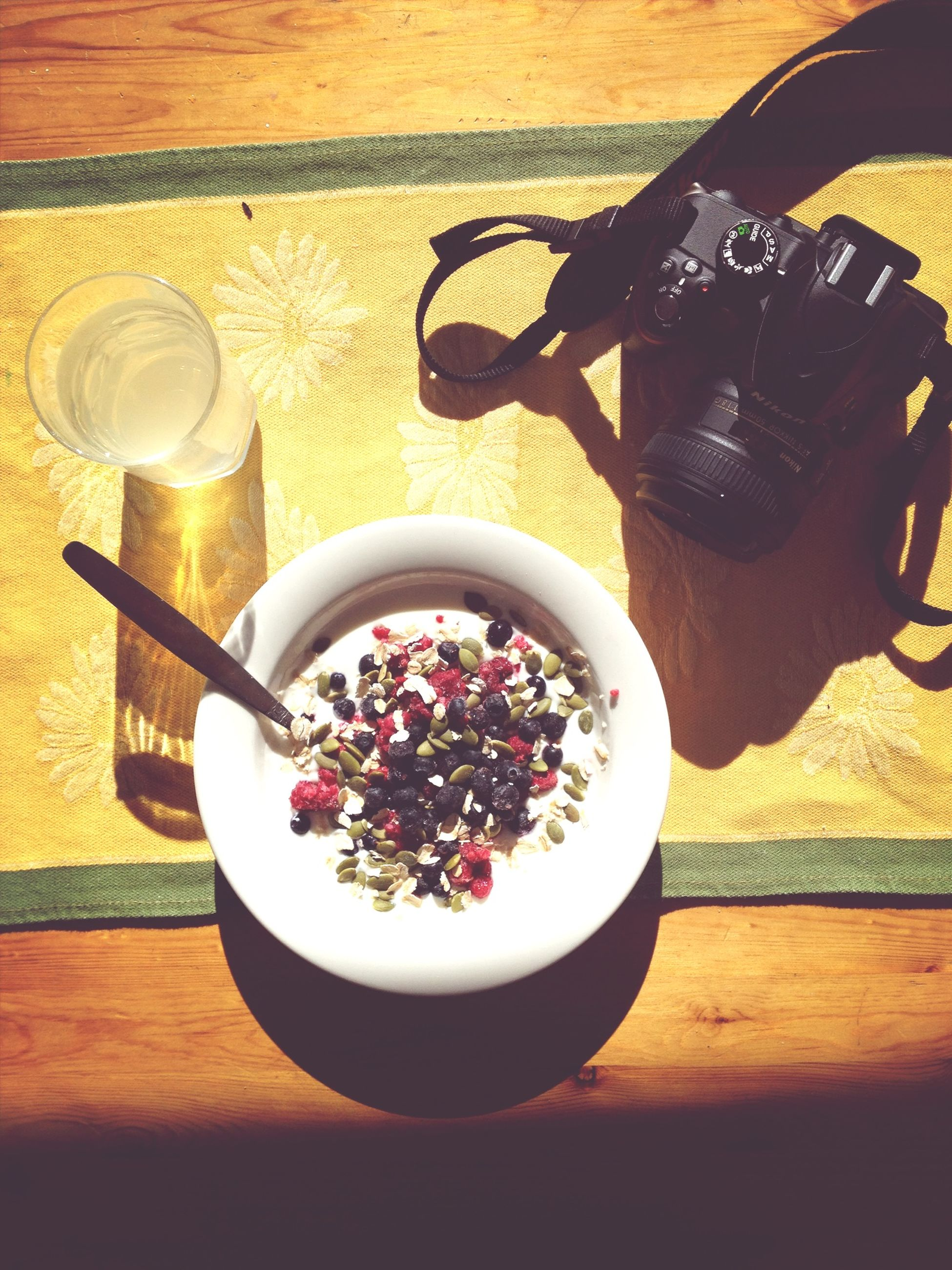 table, indoors, food and drink, freshness, still life, high angle view, drink, coffee cup, food, spoon, bowl, healthy eating, coffee - drink, refreshment, plate, flower, cup, wood - material, close-up, directly above