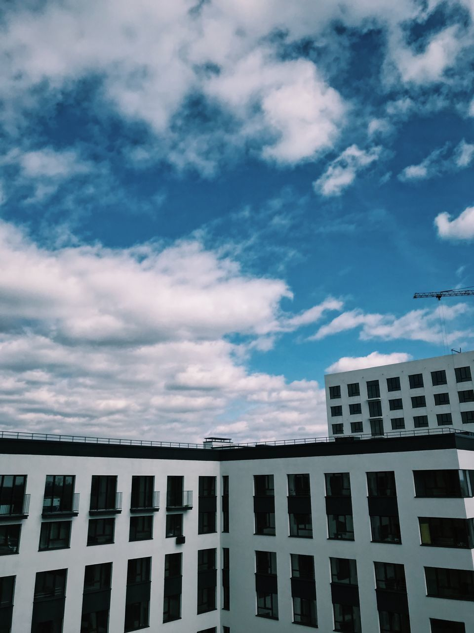 building exterior, built structure, cloud - sky, architecture, sky, building, city, low angle view, nature, window, no people, day, outdoors, residential district, office, office building exterior, modern, city life, blue, repetition, skyscraper, apartment