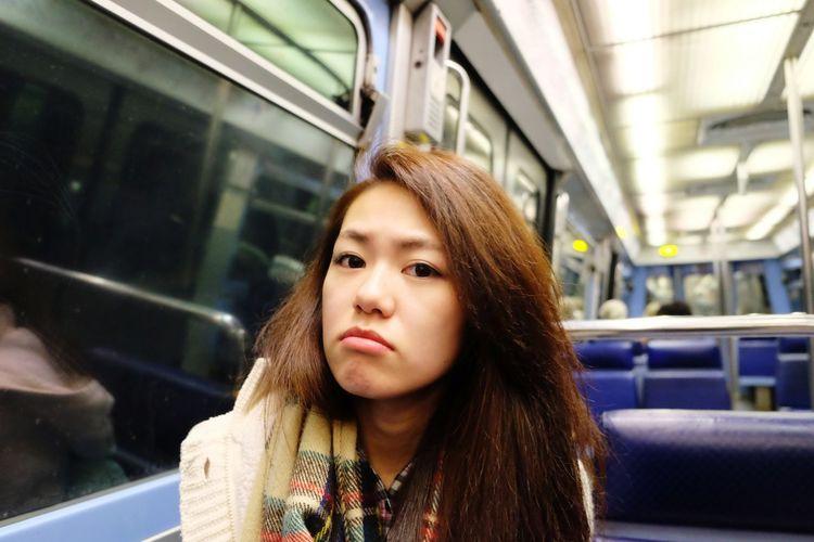 Portrait of beautiful woman in train