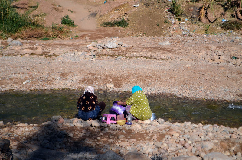 High angle view of girl and woman on land