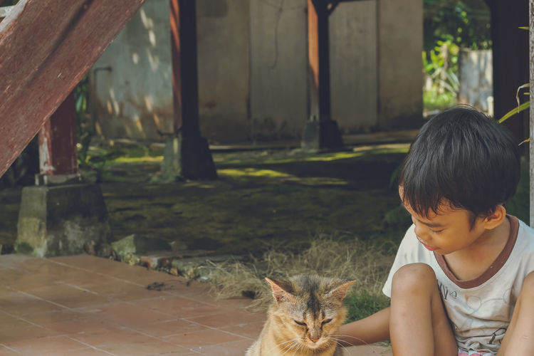 A kid and a cat