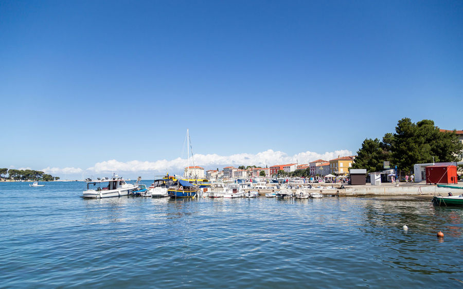 Poreč harbour... Croatia Holiday Holidays Porec, Croatia Poreč Harbour Poreč Marina Travel Architecture Blue Boat Boats Day Holiday Destination Moored Nature Nautical Vessel Outdoors Porec Sea Sky Transportation Travel Destinations Tree Water Waterfront