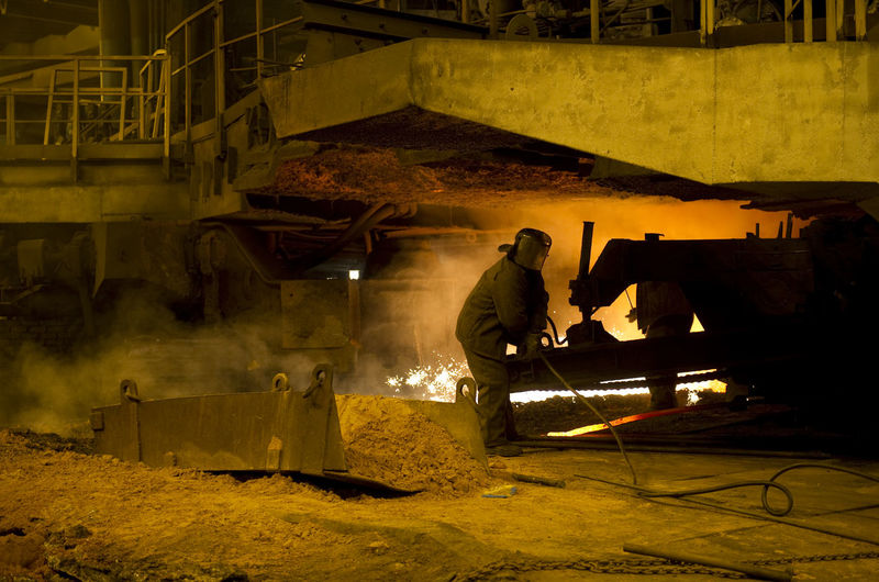 Worker Working At Factory At Night
