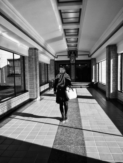 Walking Architecture Architectural Column Corridor Blackandwhite Photography Museum Real People The Hague Netherlands