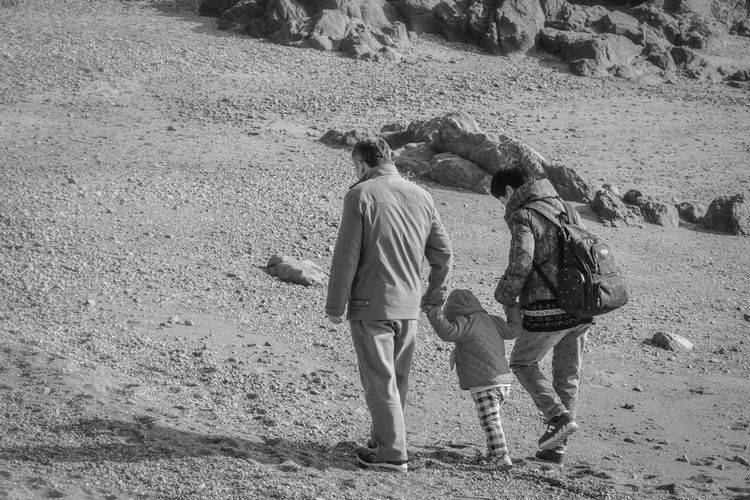 grandparent and grandchild Beach Black And White Bonding Childhood Day Leisure Activity Lifestyles Monochrome Outdoors People Real People Relationship Sand Togetherness Walking