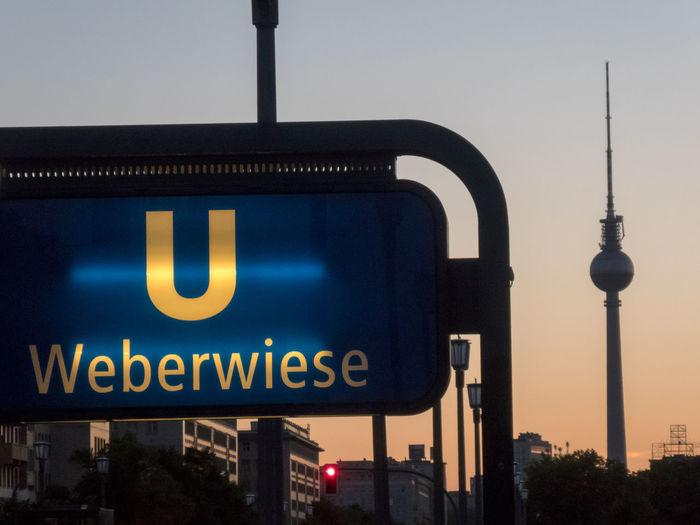 Weberwiese U-Bahn station sign, located on the U5 line under Karl-Marx-Allee directly east of Strasse der Pariser Kommune U-Bahn U-Bahn Berlin U-Bahnhof Ubahn Berlin UbahnStation Architecture Building Exterior Built Structure City No People Office Building Exterior Outdoors Skyscraper Tall - High Tourism Tower Travel Travel Destinations Ubahn Ubahn Station Weberwiese