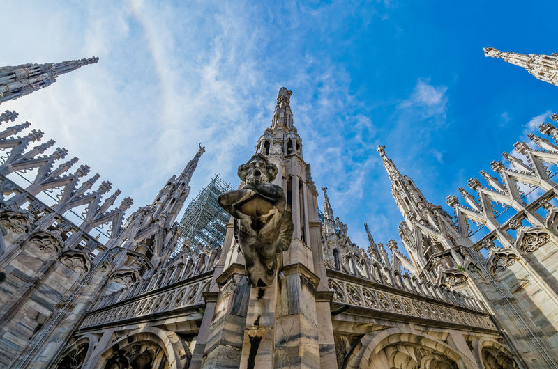 Details of the Duomo di Milano Architectural Feature Architecture Built Structure Cathedral Church Cloud - Sky Detail Dramatic Angles Duomo Di Milano Gothic Style Low Angle View Outdoors Place Of Worship Religion Sculpture Sky Travel Neighborhood Map