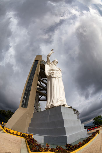 Dramatic fisheye view of the El Santisimo Jesus Statue near Bucaramanga, Colombia. Catholic Colombia Eco Park Floridablanca God Jesus Latin America Santander Statue Bucaramanga Christ Ecoparque El Santisimo Jungle Landmark Landscape Outdoors Park Religion Santisimo South America Spirituality Statue Theme White