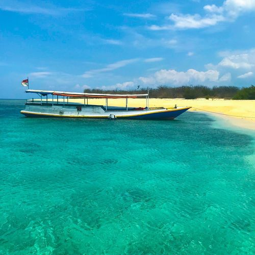Summer beach boat in clear water island chill holiday Island Beach Beauty In Nature Nature Travel Cloud - Sky Blue Scenics - Nature Waterfront Tranquility Tourism Outdoors Holiday Turquoise Colored