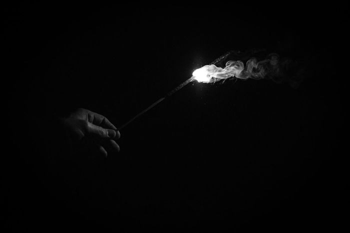 Bengal Fire Bengal Firework Bengal Light Black & White Black Background Burning Celebration Dark Fire New Year Around The World Flame Flare Fume Glowing Happy New Year Illuminated Photography In Motion Light NewYear Night Hand Simplicity Smoke Holding Light In The Darkness