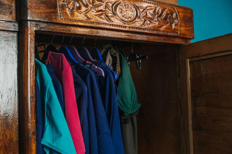 Multi colored clothes hanging on rack in store