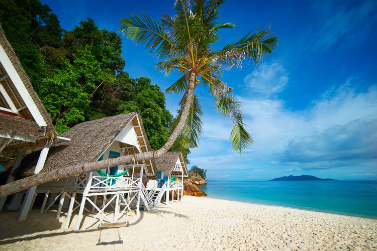 Beautiful beach aerial view over a Rawa island. White sandy beach seen from above. Malaysia . Bay Beach Beach Volleyball Beautiful Blue Calm Coast Coastline Coconut Day Dream Hot Idyllic Island Lagoon Malaysia Nature Nobody Ocean Outdoor Palm Panorama Paradise Parasol Plant Rawa Relax Relax Chair Resort Sand Scenery Scenic Sea Seascape Shore Sky Speed Boat Summer Sun Sunlight Sunny Tourism Tranquil Travel Tree Tropic Tropical Vacation Water