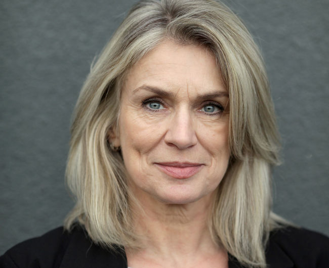 Business Woman Portrait Headshot Looking At Camera One Person Front View Mature Adult Gray Background Adult Hair Blond Hair Gray Women Close-up Studio Shot Body Part Human Body Part Human Face Gray Hair Hairstyle Beautiful Woman Baby Boomer White Hair