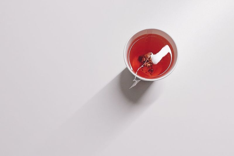 High angle view of drink on table against white background