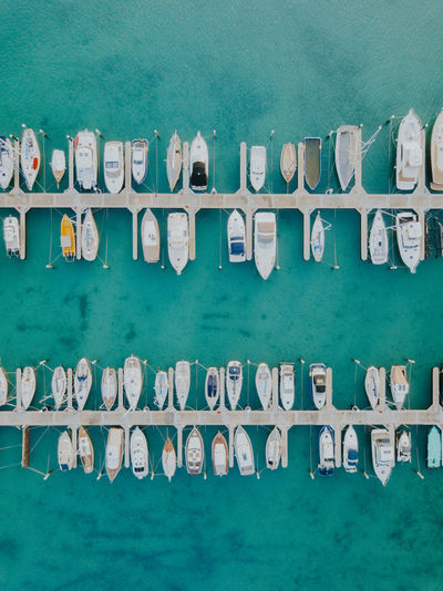 Drone  Aerial View Architecture Arrangement Boat Built Structure Close-up Day Dji Dock Green Color In A Row Large Group Of Objects Nature No People Order Outdoors Sea Side By Side Turquoise Colored Wall - Building Feature Water Waterfront