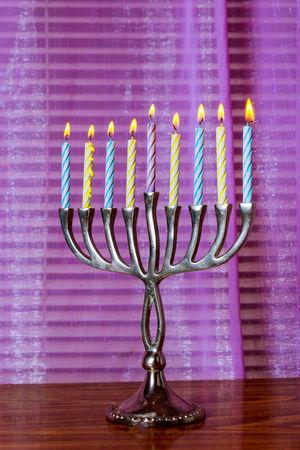 Lighting the brightly glowing Hanukkah menorah candles Torah Ancient Rituals Burning Candle Chanukah Candles Faith Hanukkah Menorah Hanukkah Candles HanukkahDecor Menorahcandles Candlelight Chanuka Chanukah Hanukkah Hanukkah Dreidel Hanukkiah Judaism Kislev Menorah Orthodox Religion Sabbath Sabbathday Synagogue