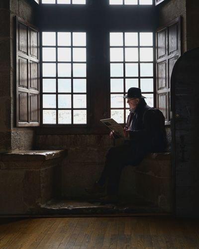 Man sitting on open window