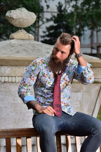 Vertical One Person Person Day People Men Fashion Casual Clothing Hairstyle Bearded London Only Men Outdoors Beard Sitting Lifestyles