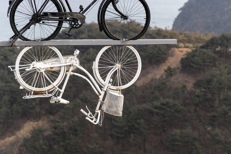 View of bicycle art craft hanging in the air