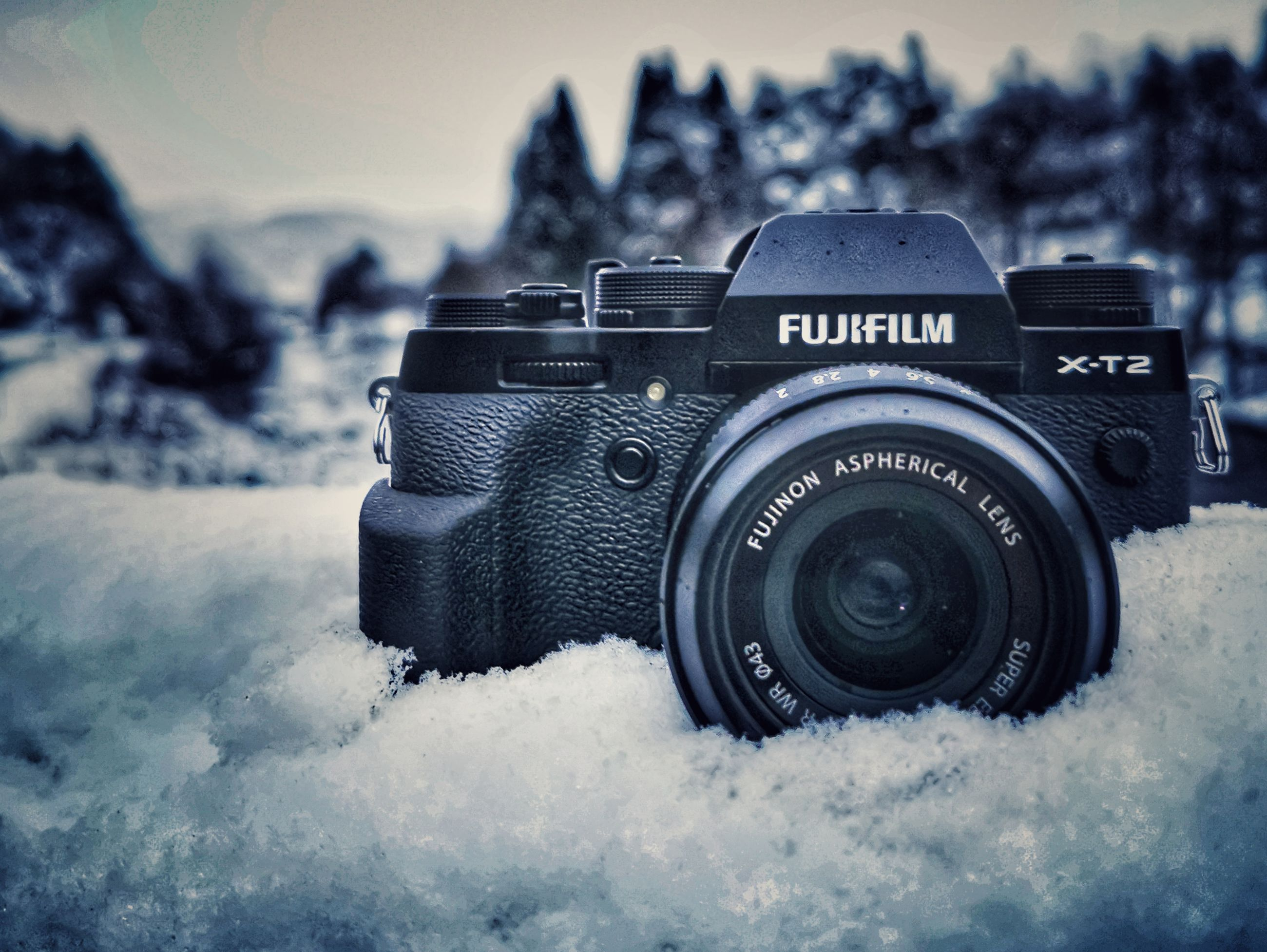 camera - photographic equipment, photography themes, technology, photographic equipment, winter, camera, focus on foreground, close-up, digital camera, snow, no people, lens - optical instrument, cold temperature, day, nature, modern, text, black color, slr camera