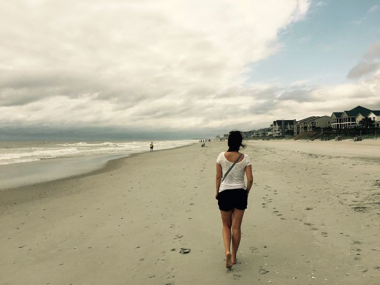 Americana Beach Walk Charleston South Carolina Surfside Beach USA America Beach Beauty In Nature Full Length Horizon Over Water Leisure Activity Lifestyles Nature One Person Rear View Scenics Sea Vacations Walking Walking On The Beach Women Young Adult An Eye For Travel