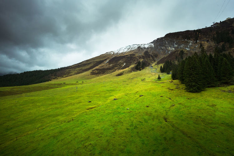 Beauty In Nature Landscape No People Day Mountain Range Scenics Tranquil Scene Sky Tranquility Mountain Outdoors Cloud - Sky Green Color Nature Grass