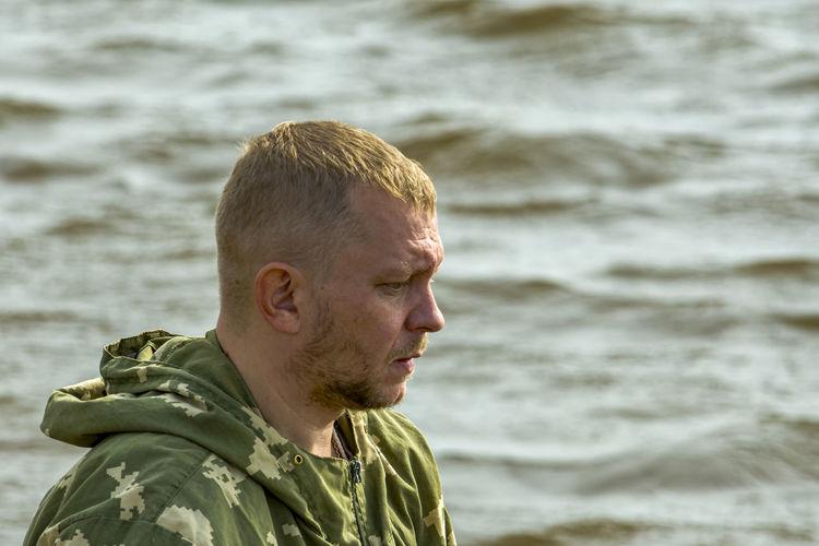Portrait of man looking at sea shore