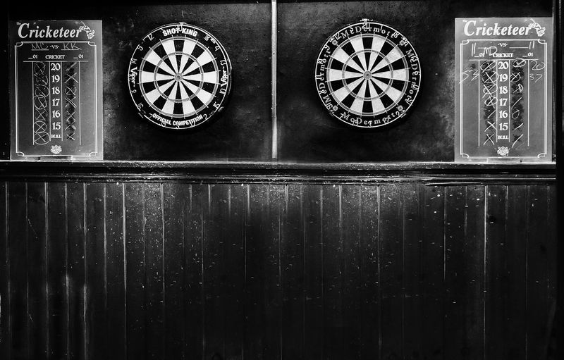 Dart Board Darts Accuracy Architecture Circle Close-up Communication Cricket Day Geometric Shape Indoors  Metal No People Number Old Retro Styled Side By Side Text Time Wall - Building Feature Wood - Material