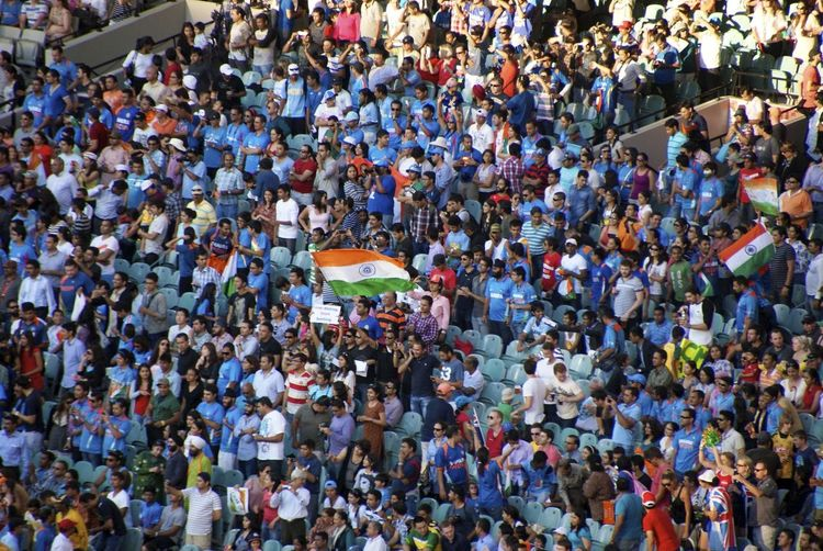 High angle view of spectators at stadium with indian flags