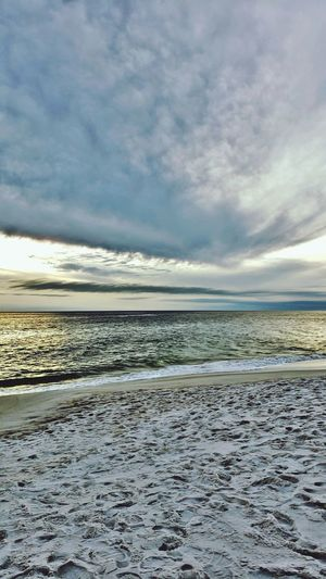 Touchdown storm clouds Water Sea Beach Sunset Wave Cold Temperature Low Tide Ice Polar Climate Frozen Water