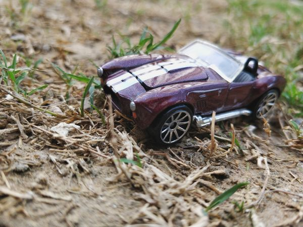 one more Car Kids Motorsport Kid Play Grass Natural Background Car In Nature Childhood Abandoned Field Toy Close-up Toy Car Run-down Vehicle Windscreen