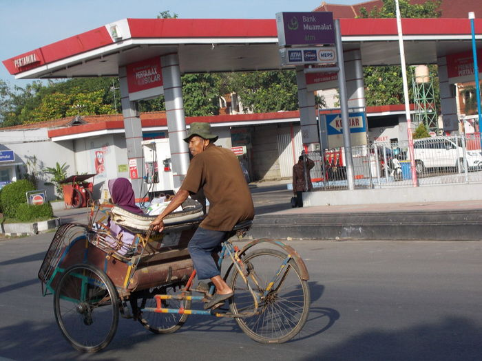 Beca Becak Bicycle Building Exterior City INDONESIA Kudus Men Mode Of Transport Person Rickshaw Riding Street Streets Traditional Traffic Transport Transportation Travel Travelling