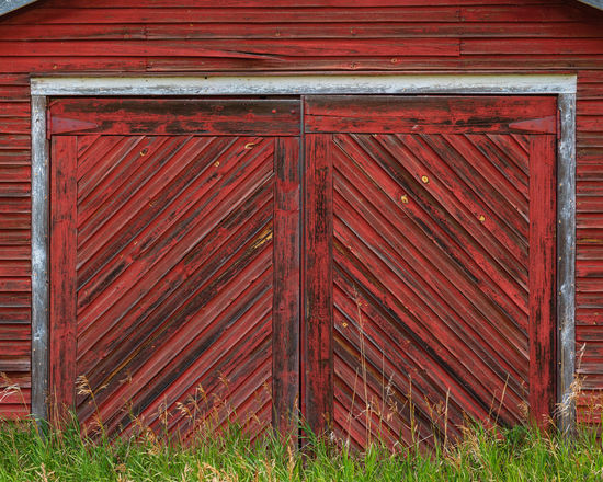 Barn Doors Architecture Building Building Exterior Built Structure Closed Day Door Entrance Grass House Nature No People Outdoors Pattern Plant Protection Red Safety Security Wood - Material