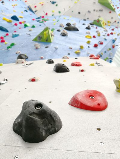 Climbing wall details Route Difficulty Climbing Wall Bouldering Indoor Hall EyeEm Selects Close-up Climbing Free Climbing Climbing Equipment Mountain Climbing Clambering Rock Face Safety Harness Climbing Rope Steep Rock Climbing Rappelling